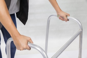 Close up of woman using Walker on white background