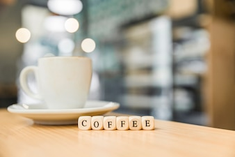 Close-up of wooden coffee cubic blocks with coffee in caf�