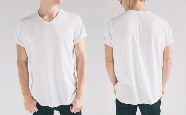 空白の白いtシャツの前面と背面の若い男のクローズアップ