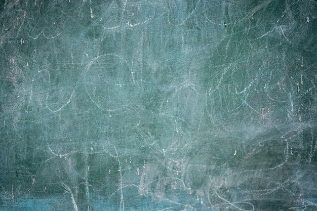 Close up of old blackboard with white chalk background, grunge texture.