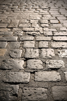 Close up of old cobblestone road