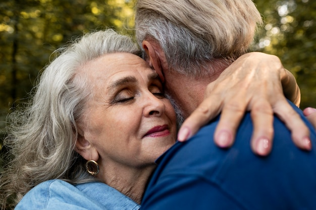 Close up old couple hugging