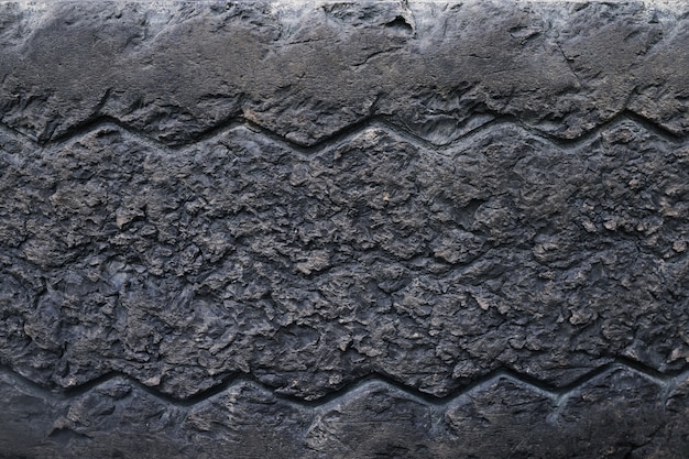 Close up old damaged and worn black tire tread truck. tire tread problems and solutions for road safety