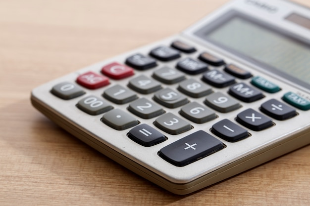 Close-up of old dirty calculator on table