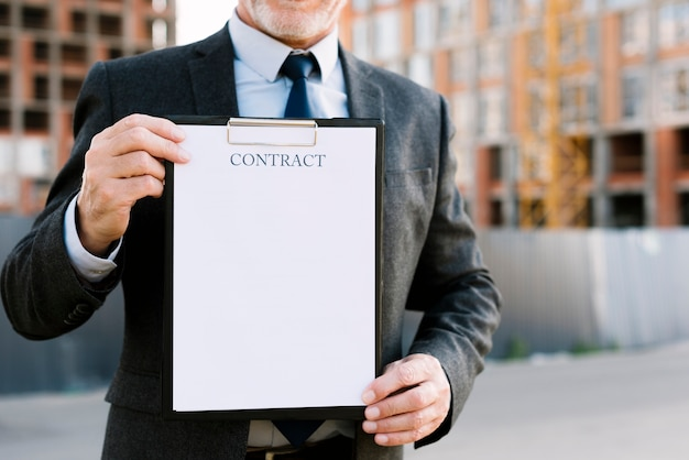 Close-up old man with contract