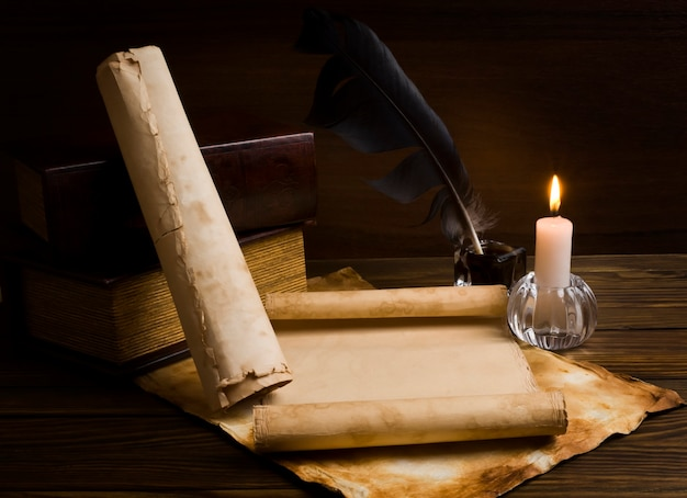 Close up on old papers and books on a wooden table