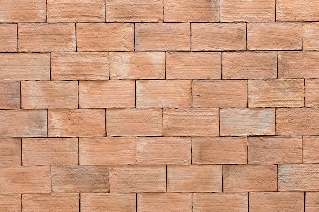 古い赤レンガの壁のシームレスな背景、茶色のレトロなグランジパターンの表面建築構造をクローズアップ