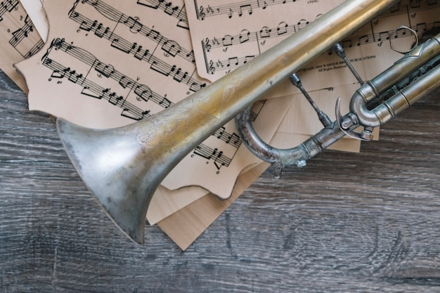 Close-up old trumpet on sheet music