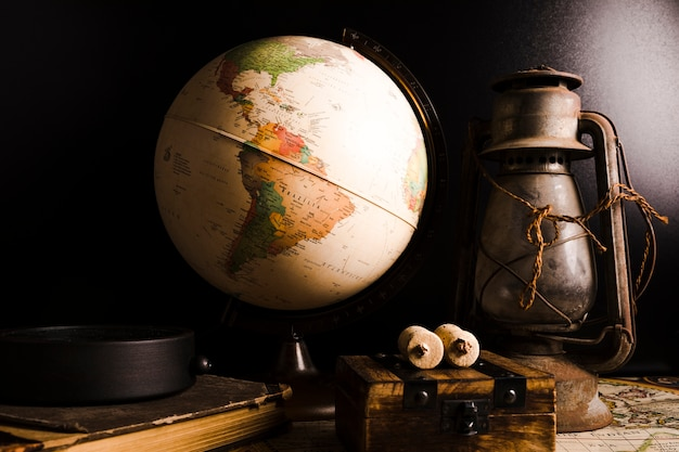 Close-up of old vintage globe and lantern