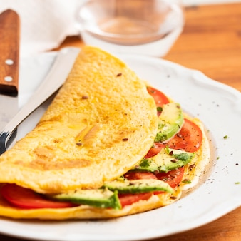 Close-up of omelet with tomatoes and avocado