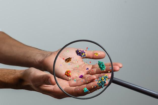 皮膚接触3dレンダリングによる虫眼鏡伝達ウイルスを介して病人の手にクローズアップ