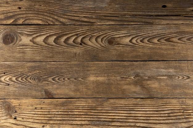 Закройте на деталях текстуры старого дерева