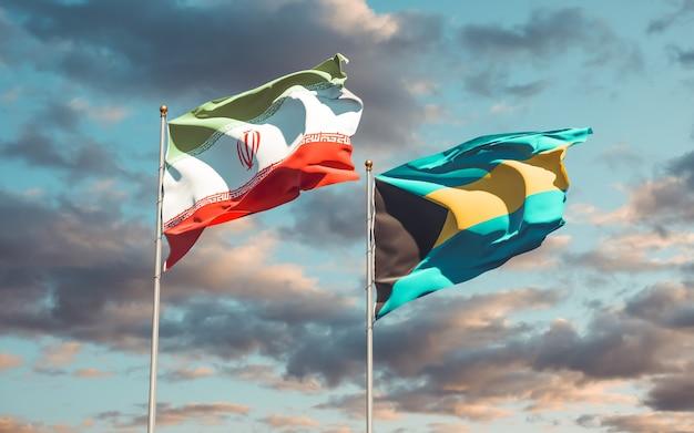 Закройте на флагах ирана и багамских островов