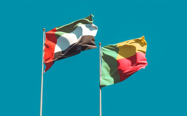 Закройте на флагах оаэ, арабских эмиратов и бенина