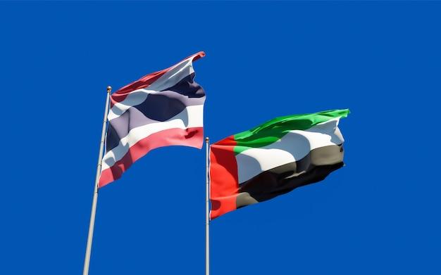 Закройте на флагах объединенных арабских эмиратов, оаэ и таиланда