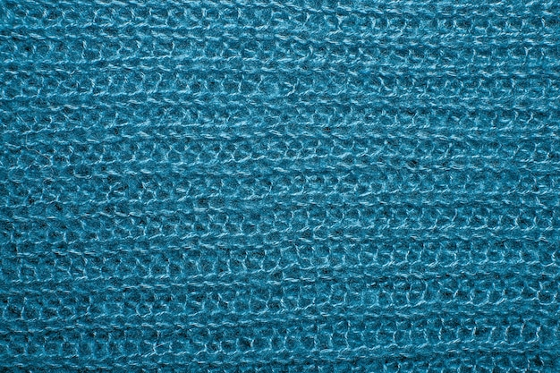 Закройте на вязать шерстяной меховой текстуры. синий пушистый свитер из тканой нити в качестве фона.