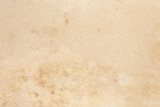 Закройте на старых обоях текстуры коричневой бумаги