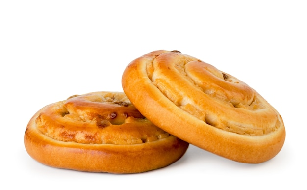 Крупным планом на изолированные булочки с улитками