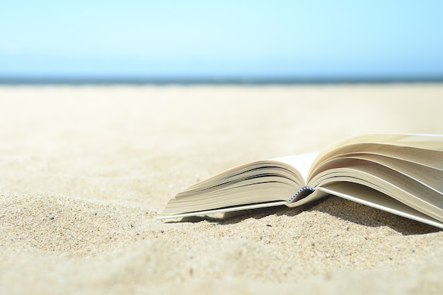 Close up of open book on the beach