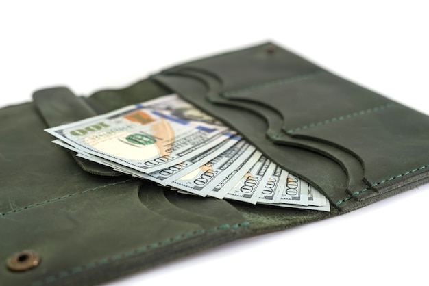 Close-up of an open female wallet with dollars inside. isolated.
