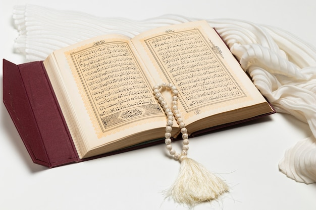 Close-up open holy book with bracelet