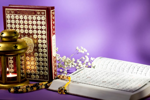 Close up open quran with purple background