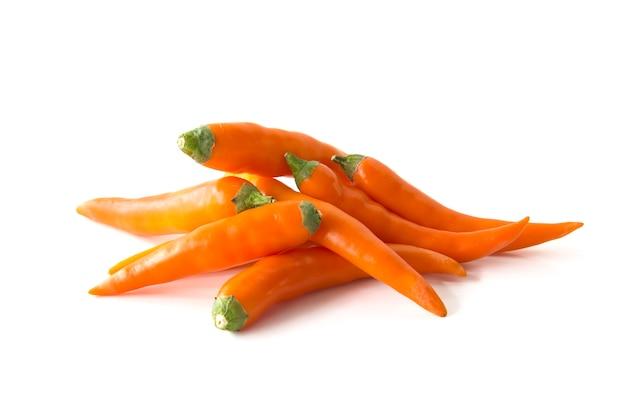 Close up orange hot chili pepper isolated on a white background