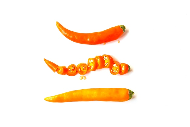Close up orange hot chili pepper isolated on a white background