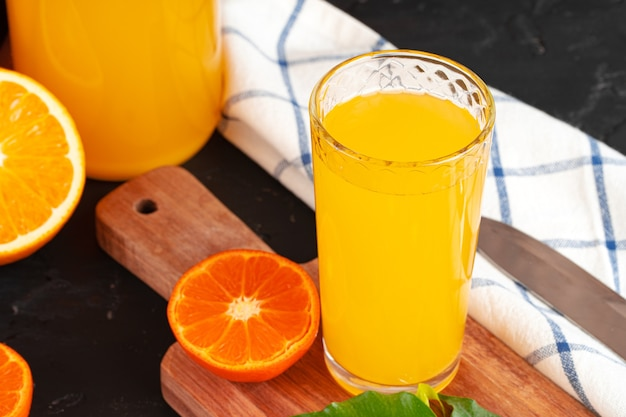 Close up of orange juice glass on wooden table