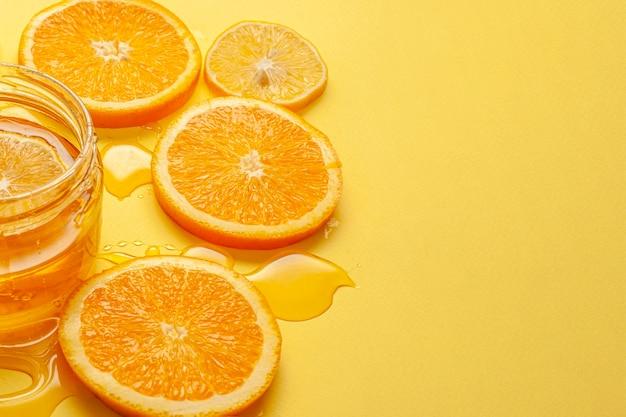 Close-up orange slices with honey