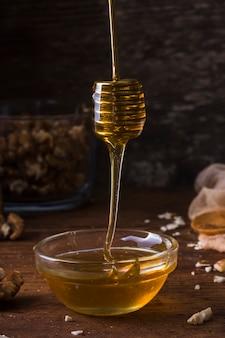 Close-up organic honey pouring