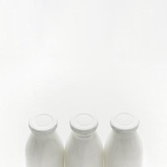 Close-up organic milk bottles with copy space