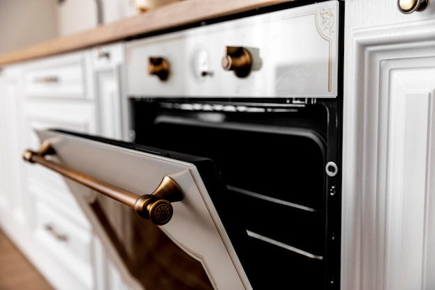 Close-up oven with golden details