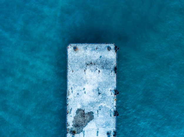 Close up overhead view of ocean sea pier simple concept isolated design