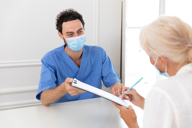 Close up on pacient talking to doctor about vaccine