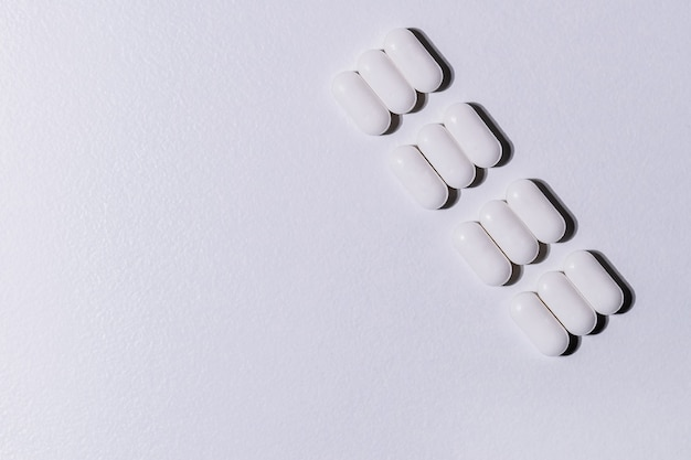 Close up package of tablets on a gray background