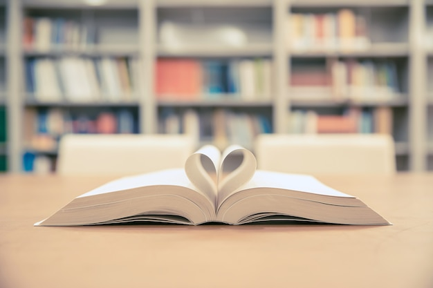 Close up page of a book in heart shape.