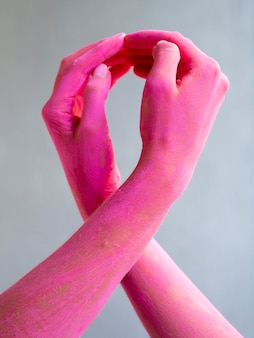 Close-up painted arms expressing cancer awareness
