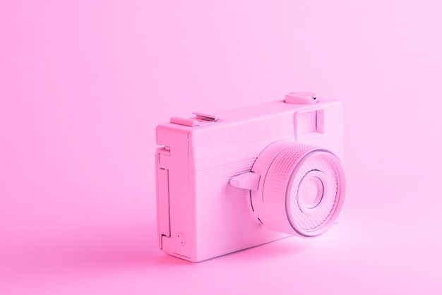 Close-up of painted camera against pink background