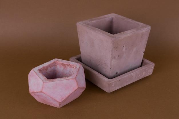 Close up  painted concrete pots,  trendy element of  modern interior design