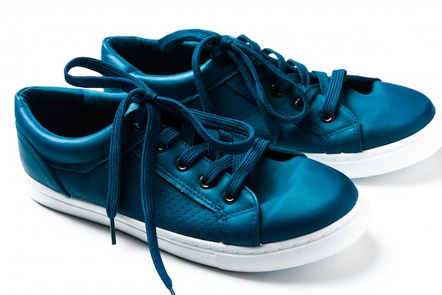 Close up pair of blue sneakers isolated on white background