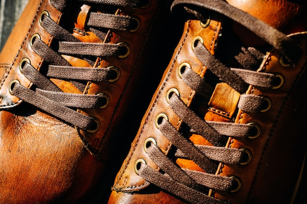 Close up of pair of men's brown leather shoes.