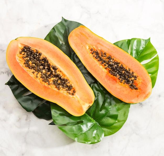 Close-up papaya on monstera leaf
