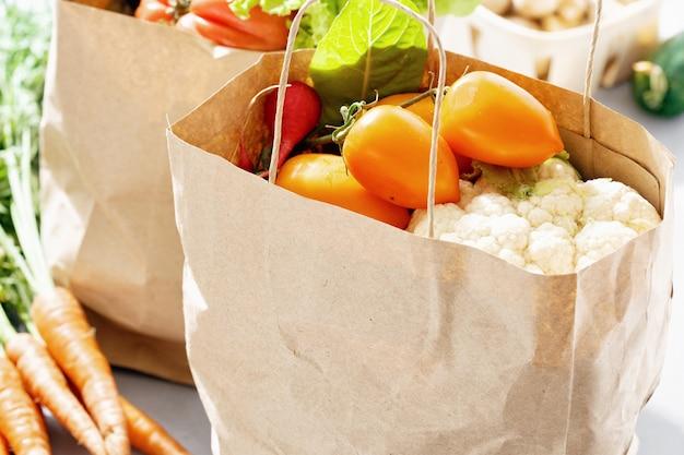 Close up paper bag fresh vegetables