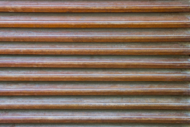 Close up, parallel wooden slats texture. as an element of decor interior and ventilation.