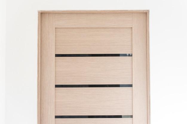 Close-up part of modern wooden door in living room, interior