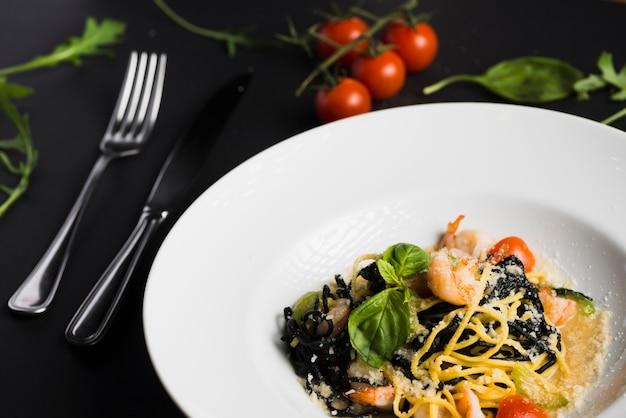 Close-up pasta near utensils