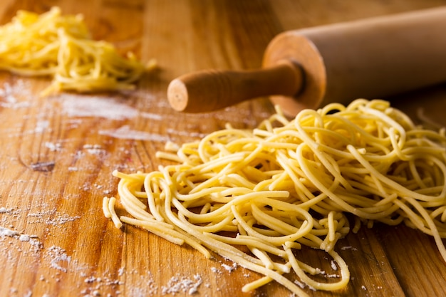Close-up of pasta and roller