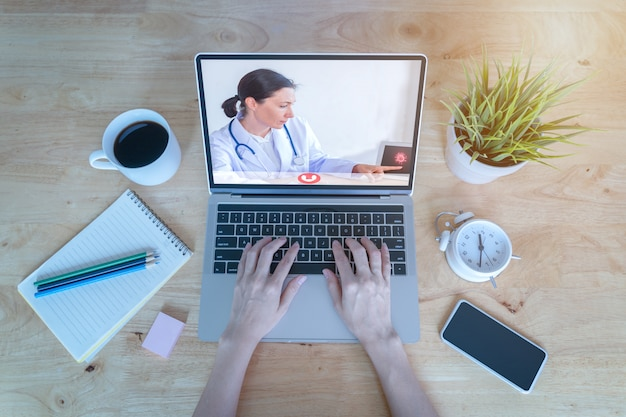 Close up patient talk consult with doctor using video call on laptop