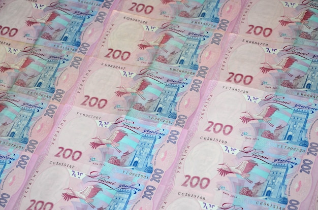 A close-up of a pattern of many ukrainian currency banknotes
